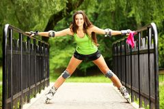 Woman roller skating sport activity in park Royalty Free Stock Images