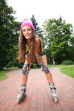 Woman roller skating sport activity in park Royalty Free Stock Image