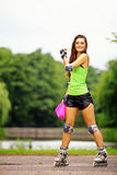 Woman roller skating sport activity in park Royalty Free Stock Photography