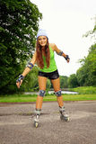 Woman roller skating sport activity in park Royalty Free Stock Photo