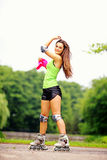 Woman roller skating sport activity in park Stock Images