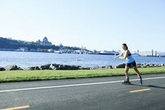 Woman with is rollerblade in summer time Royalty Free Stock Images
