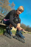 Woman with Rollerblades Royalty Free Stock Images