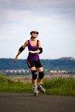 Woman on rollerblades Royalty Free Stock Photos
