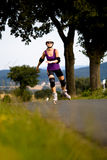 Woman on rollerblades Royalty Free Stock Images