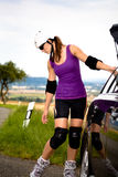 Woman on rollerblades in the country Stock Photo