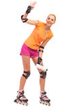 Woman on rollerblades waving hand. Royalty Free Stock Photos