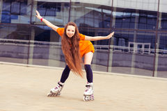 Woman on  rollerblading in city on a sunny day Stock Images