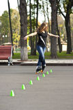 Woman rollerblading in the park in spring Royalty Free Stock Photos