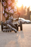 Woman Rollerblading While Pushing Baby Stroller Stock Photography