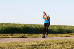 Woman rollerblading Royalty Free Stock Photos