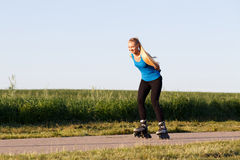 Woman rollerblading Royalty Free Stock Photography
