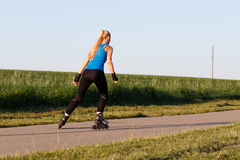 Woman rollerblading Stock Photo