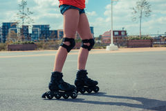 Woman rollerblading on sunny day Stock Images