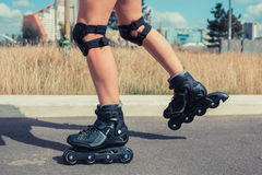 Woman rollerblading on sunny day Royalty Free Stock Photos