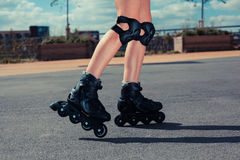 Woman rollerblading on sunny day Royalty Free Stock Images