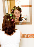 Woman with rollers Stock Image