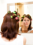 Woman with rollers Stock Photography