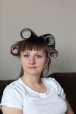 Woman in rollers Stock Image