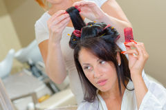 Woman with rollers in hair Stock Photography