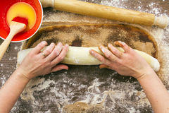 Woman rolling cinnamon roll Stock Photography
