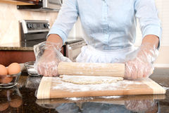 Woman Rolling Dough Stock Photos