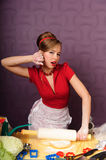 Woman Rolling Dough Stock Photography