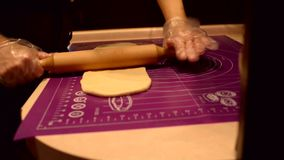 Woman rolling dough for baguette stock video