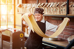 Woman rolling dough in cafe Royalty Free Stock Photos