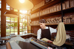 Woman rolling dough in cafe Royalty Free Stock Photography