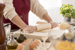 Woman rolling the dough Royalty Free Stock Photography