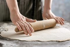 Woman rolling dough for ravioli Stock Photo