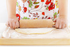 Woman rolling dough using rolling pin Stock Image