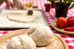 Woman is rolling out dough Stock Images