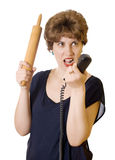 Woman with a rolling pin on the phone screaming Stock Images