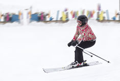 Woman rolls skis Stock Photography