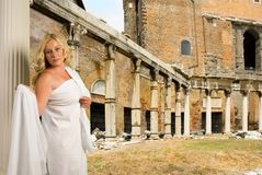 Woman in the Roman forum. Woman in toga with a view of trajans market and the roman forum Royalty Free Stock Photo