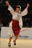 Woman in Romanian national outfit perform during dancesport competition Stock Photos
