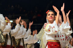 Woman in Romanian traditional outfit perform during dancesport competition Stock Photo