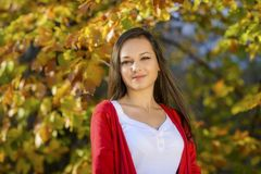 Woman in a romantic autumn scenery Stock Photo
