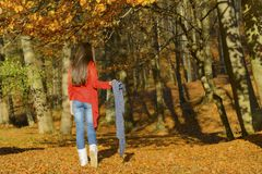 Woman in a romantic autumn scenery Royalty Free Stock Photo