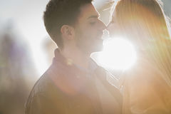 Woman romantic love kiss man in urban city. Woman romantic love kiss men in urban city Royalty Free Stock Photo