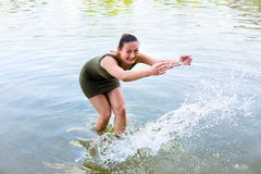 Woman romping cheerful in lake water Royalty Free Stock Photography