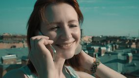 Woman on the roof. Girl walking on the roof and talking on the phone stock footage