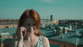 Woman on the roof. Girl walking on the roof and talking on the phone stock video footage