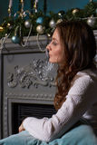 Woman in room with Christmas decoration. Stock Photo