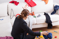 Woman in room of messy clothes Royalty Free Stock Photography