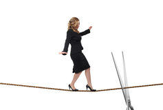 Woman on rope. Young blonde acrobat on rope isolated on white and silver scissor Royalty Free Stock Images