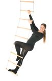 Woman on a rope ladder. Isolated photo of a woman on a rope ladder Stock Image