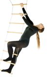 Woman on a rope ladder. Isolated photo of a woman on a rope ladder Stock Photos